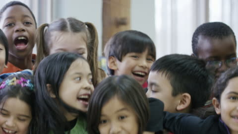 happy ethnic group of diverse third graders - child stock videos & royalty-free footage