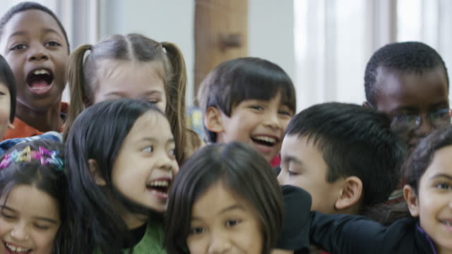 happy ethnic group of diverse third graders - classroom stock videos & royalty-free footage