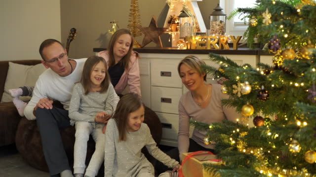 happy family at christmas tree - family with three children stock videos & royalty-free footage