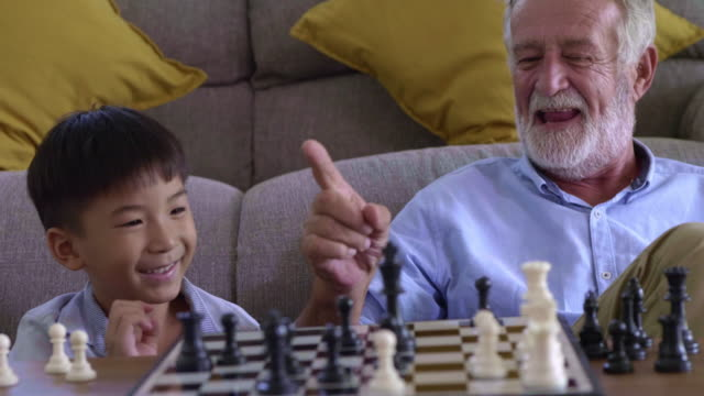 happy family at home - chess stock videos & royalty-free footage