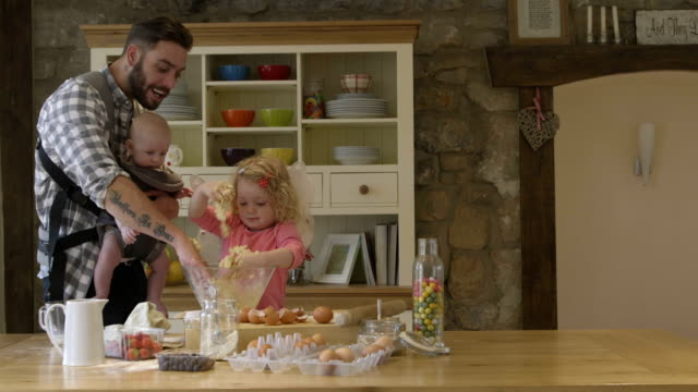 happy family baking - baby boys stock videos and b-roll footage