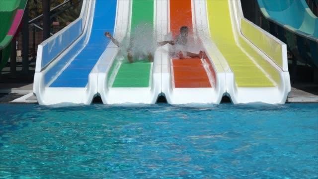 vídeos de stock e filmes b-roll de happy family beach and in swimming pool - montagem