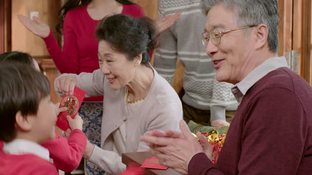 happy family celebrating chinese new year,4k - visit stock videos & royalty-free footage