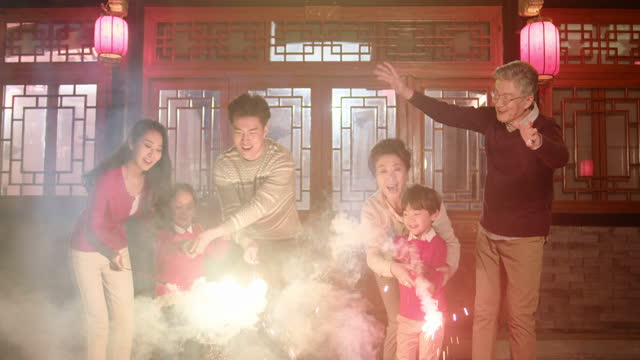 happy family celebrating chinese new year,4k - firework display stock videos & royalty-free footage