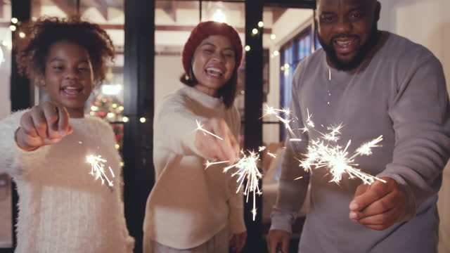 happy family celebrating christmas and having fun with sparklers - sparkler stock videos & royalty-free footage