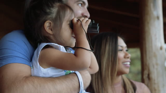 happy family child looking throuh binoculars - binoculars stock videos & royalty-free footage