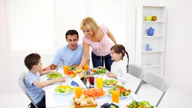 happy family dining at the home. - dinera bildbanksvideor och videomaterial från bakom kulisserna