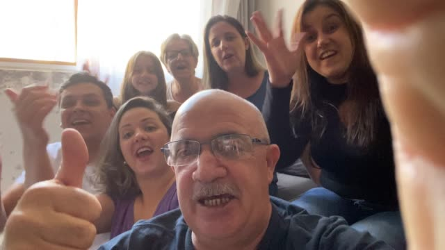 happy family doing video call at home - active seniors stock videos & royalty-free footage