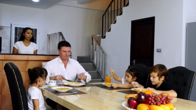 happy family enjoy eating meal at kitchen table together - happy meal stock videos and b-roll footage