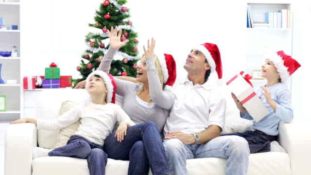 happy family get christmas gift. - christmas gift stock videos & royalty-free footage