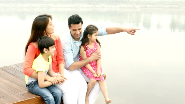 ms happy family having fun on wooden jetty over lake / india - tickling stock videos & royalty-free footage