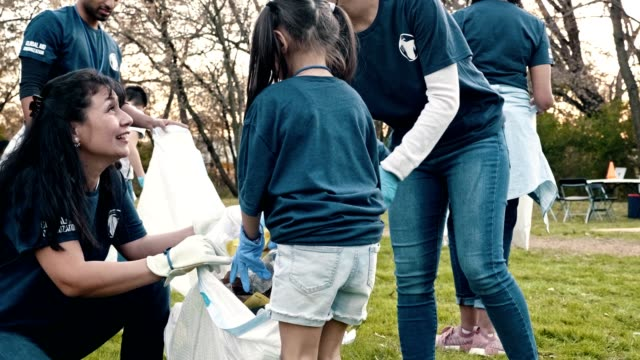 happy family help neighbors clean up their community - volunteer stock videos & royalty-free footage