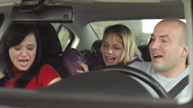 hd: happy family in a car - singing stock videos and b-roll footage