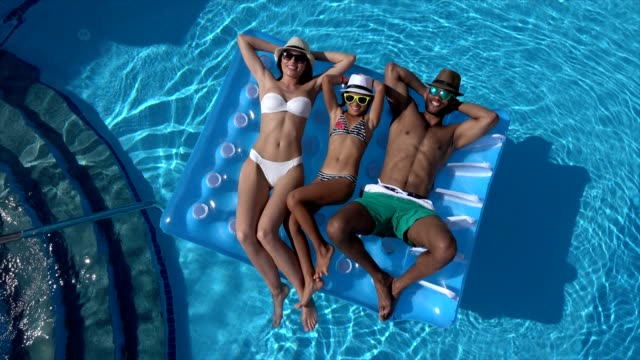 happy family in swimming pool - swimming pool stock videos & royalty-free footage