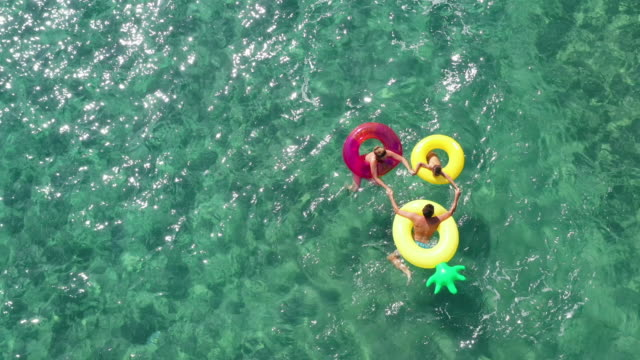 happy family in the sea - rubber ring stock videos & royalty-free footage