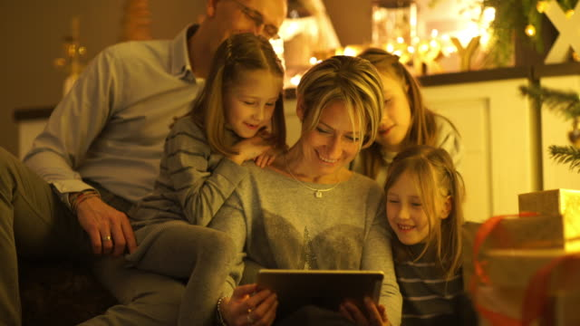 happy family looking into tablet - family with three children stock videos & royalty-free footage