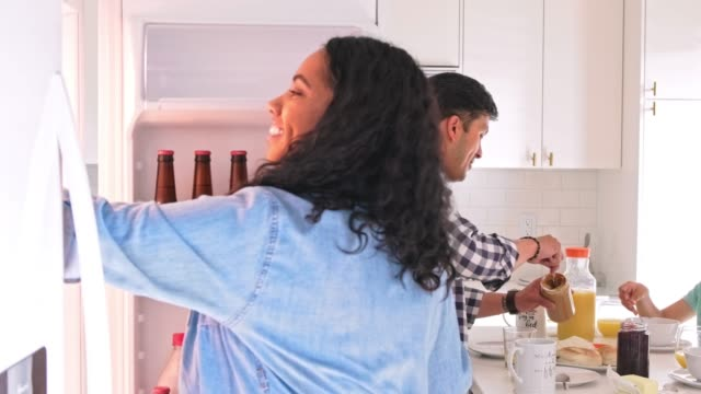 happy family of four having breakfast in kitchen - refrigerator stock videos & royalty-free footage