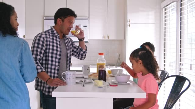 happy family of four having breakfast in kitchen - breakfast stock videos & royalty-free footage
