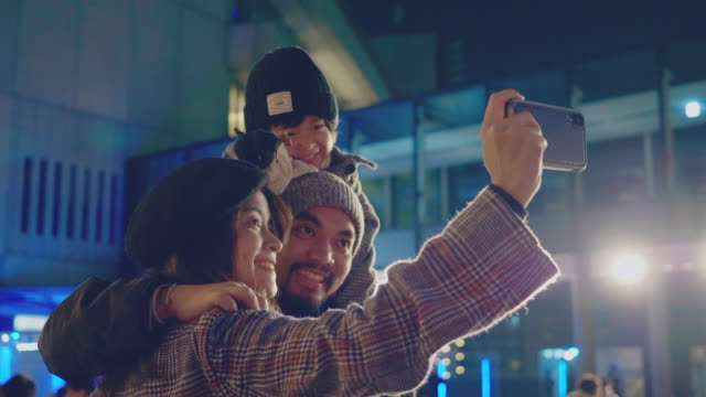 happy family of tourists take selfie in christmas market fair in japan. - traditional festival stock videos & royalty-free footage