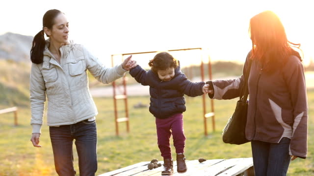 happy family on playground - zia video stock e b–roll