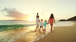 Happy Family on the Beach at Sunset