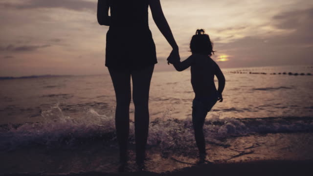 happy family on the beach - dramatic sky stock videos & royalty-free footage