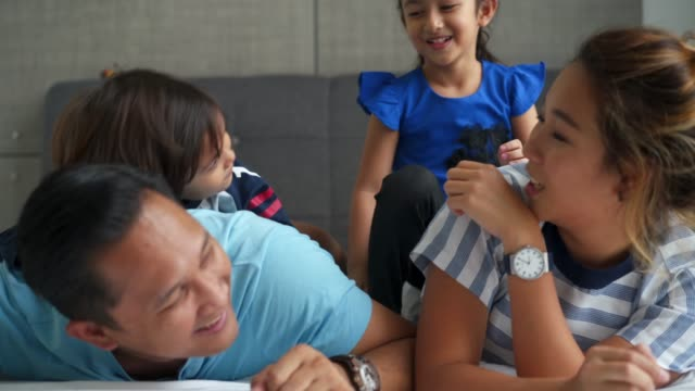 happy family on the bed together - legs apart stock videos & royalty-free footage