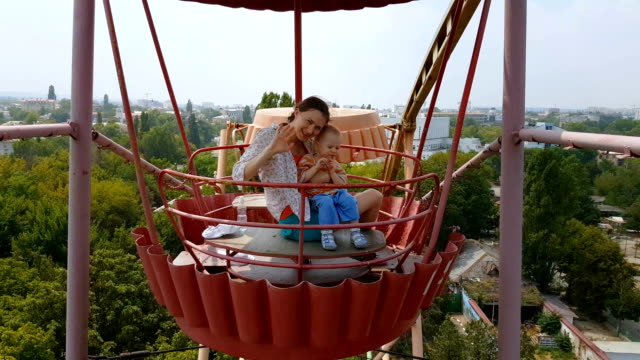 happy family on the ferris wheel - ferris wheel stock videos & royalty-free footage