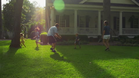 happy family playing in yard slow motion - porch stock videos & royalty-free footage
