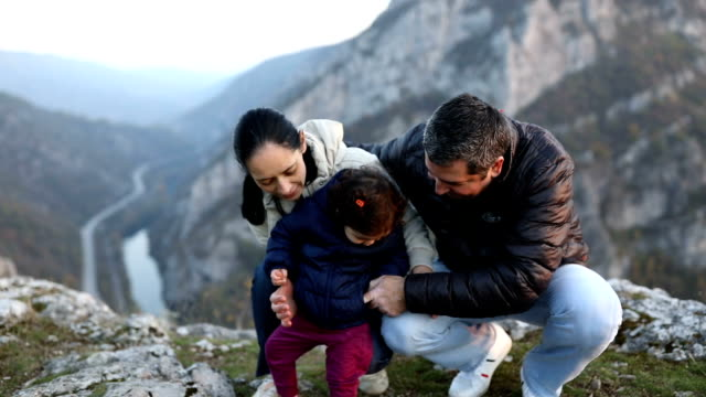 happy family reaching the peak - mountain range stock videos & royalty-free footage