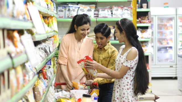 happy family shopping at supermarket - indian ethnicity stock videos & royalty-free footage