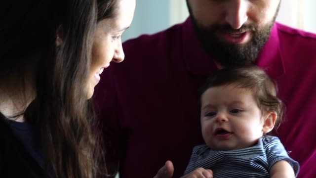 happy family together with their new baby at home - pardo brazilian stock videos & royalty-free footage