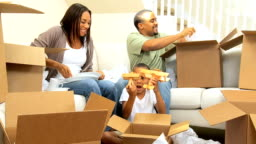 Happy Family Unpacking After House Move