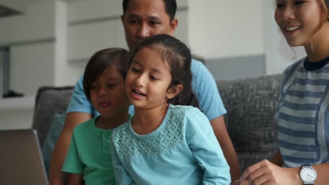 happy family using laptop together - malaysia stock videos & royalty-free footage