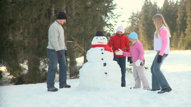 hd: happy family - making a snowman stock videos & royalty-free footage