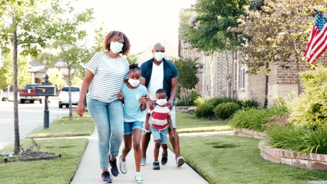 happy family walk in their neighborhood during the coronavirus pandemic - prevention stock videos & royalty-free footage