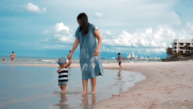 happy family walking on the beach - 6 11 months stock videos & royalty-free footage