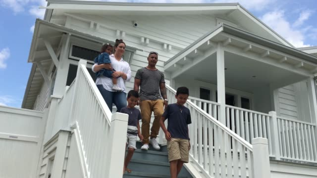 happy family walks out of their new home - pacific islander family stock videos & royalty-free footage