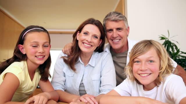 happy family waving at the camera - family waving stock videos & royalty-free footage