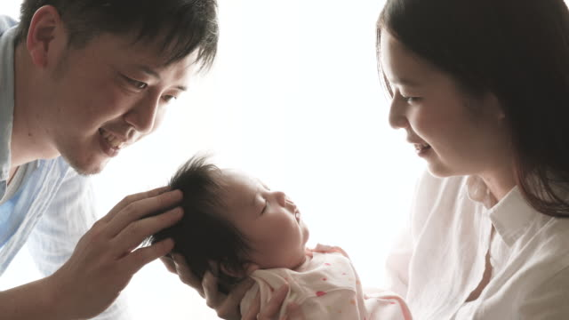 happy family with newborn baby - japanese ethnicity stock videos & royalty-free footage