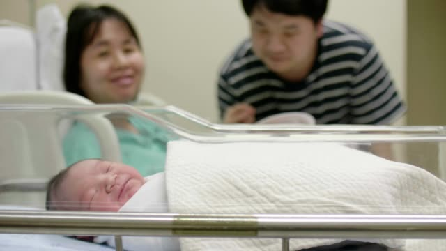 happy family with one child - delivery room stock videos & royalty-free footage