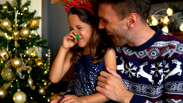 Happy father and daughter celebrate Christmas and New Year's Eve