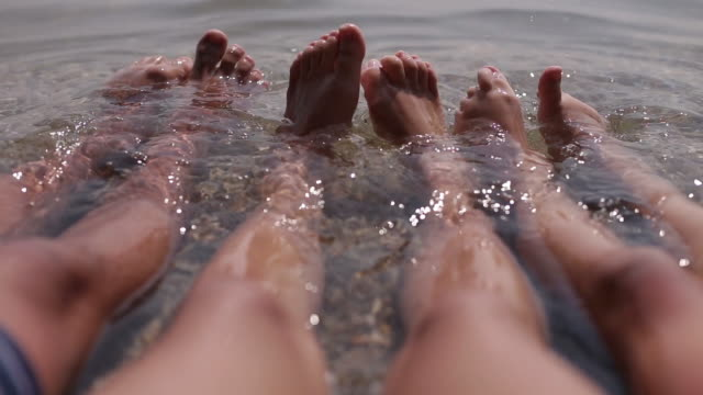 happy feet - sun cream stock videos and b-roll footage