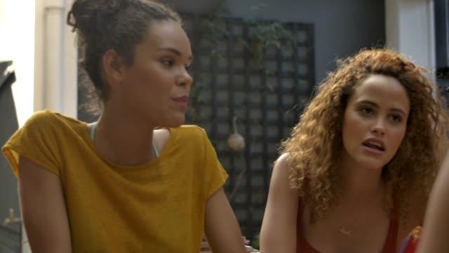 happy female friends talking at hotel - 14歳から15歳点の映像素材/bロール