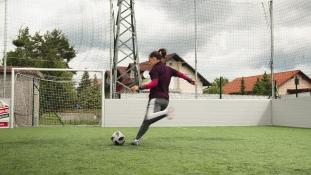 happy female soccer player practicing her shoot - slow motion - turf stock videos & royalty-free footage