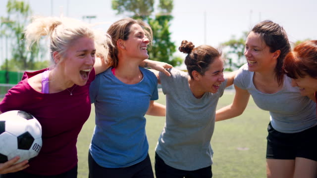 happy female soccer team embracing and celebrating great victory - sports team stock videos & royalty-free footage