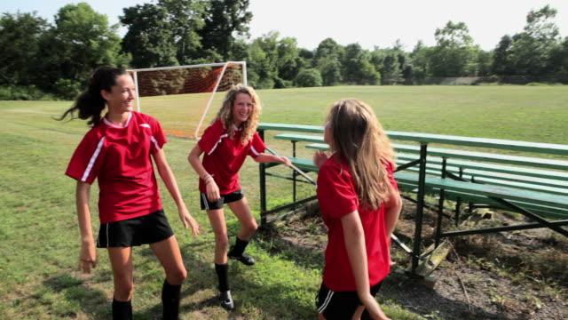 Happy female soccer teammates