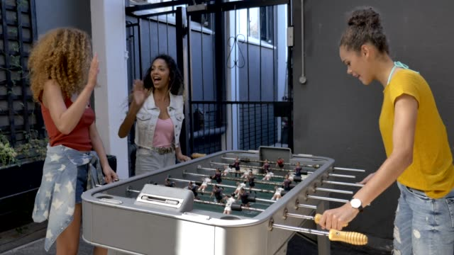 happy females playing foosball at hotel - 18 19 years stock videos & royalty-free footage