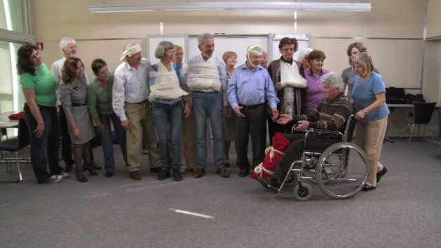 hd: happy first aid class of injured seniors - first aid stock videos & royalty-free footage