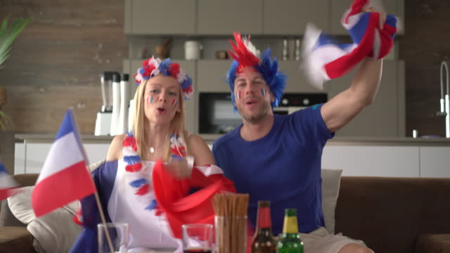 happy french fan couple cheering for france - fan enthusiast stock videos & royalty-free footage